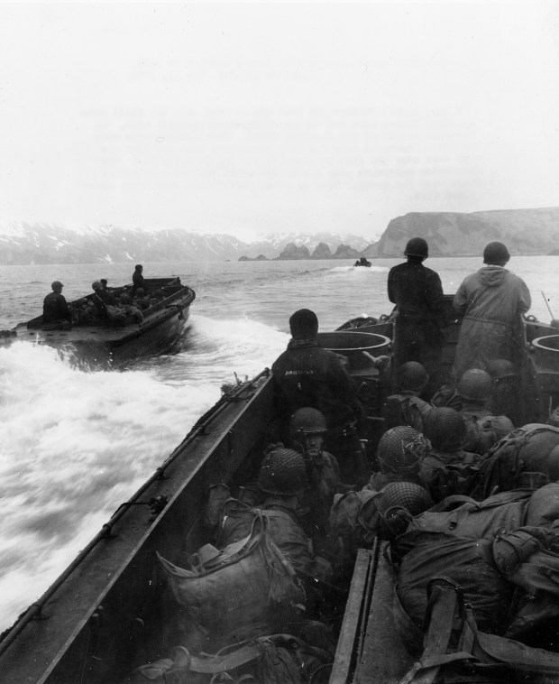 May 11, 1943: American invasion troops of the 7th Infantry Division approach a landing area code-named Beach Red in the western arm of Holtz Bay, on Japanese-occupied Attu island in Alaska.