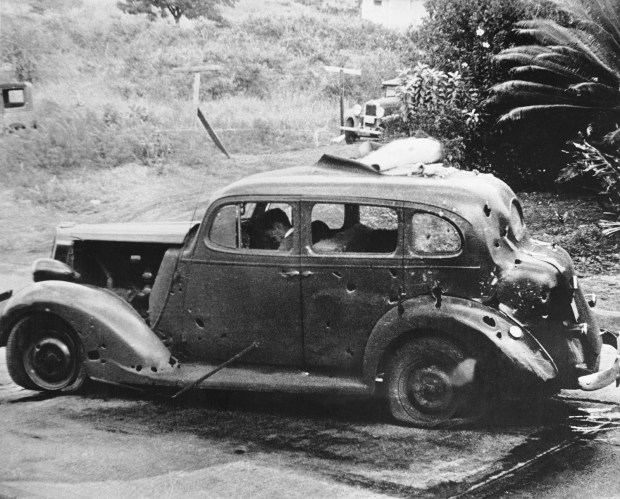 December 7, 1941: Eight miles from Pearl Harbor, shrapnel from a Japanese bomb riddled this car and killed three civilians in the attack. Two of the victims can be seen in the front seat. The Navy reported there was no nearby military objective.