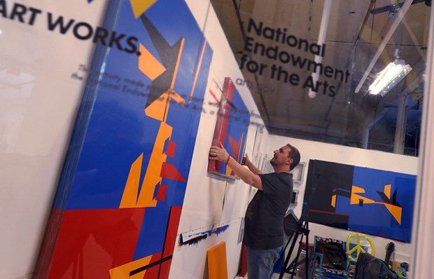 Claudio Roncoli, a recipient of an award from the National Endowment for the Arts, works in his studio in Miami on March 16. President Donald Trump's budget calls for eliminating the NEA and the National Endowment for the Humanities.