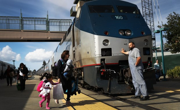 An Amtrak engineer leans on the ...