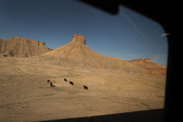 Amtrak's California Zephyr passes rock formations ...