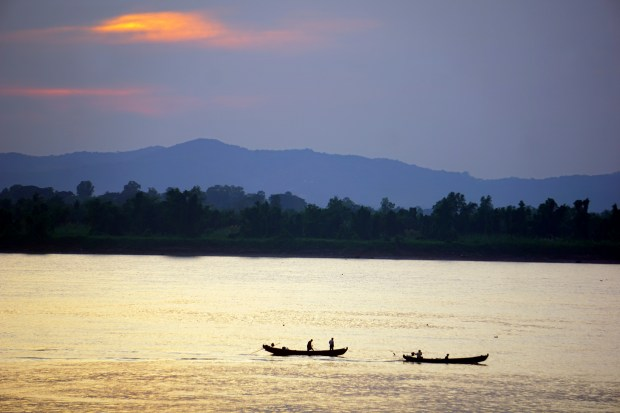 The last of the day's fishing boats ply the Salween River which flows by Mawlamyine to the Gulf of Martaban. Mawlamyine was once a major trading port as well as a hub for smugglers from nearby Thailand.