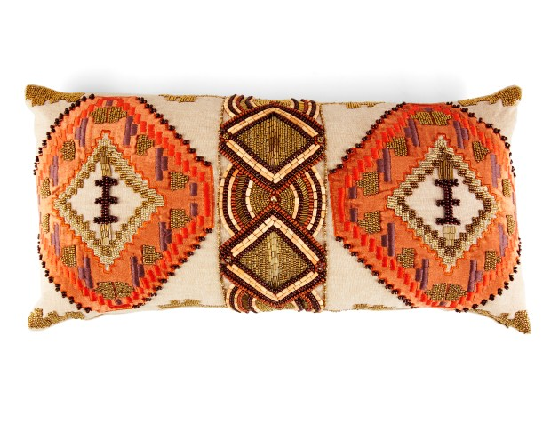 A pillow with beading on a decorative print.