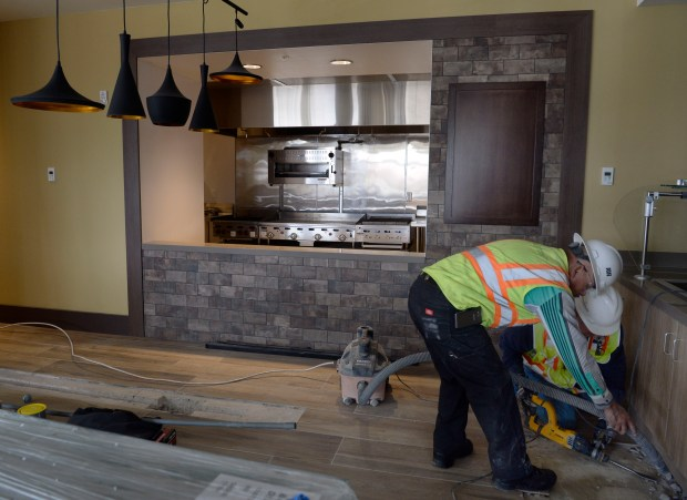 The Hilton Garden Inn prepares to open on March 6 in Arvada, with construction crews working on the finishing touches in the kitchen area.