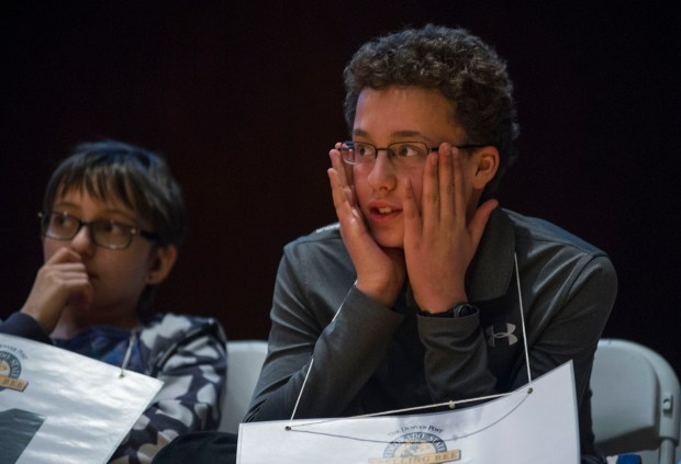 Denver School of the Arts eighth grade student Carter Ottele reacts to another competitor misspelling a word during the Denver Post Colorado State Spelling Bee, March 11, 2017 at University of Denver Sturm Hall.