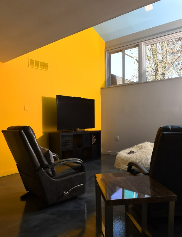 The Colemans' basement has a yellow ...