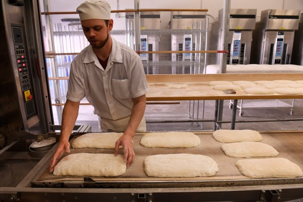 Head AM baker John Groundwater gets ready to put freshly made ciabatta bread dough into the oven for baking at The Grateful Bread Company on March 23, 2017 in Golden.