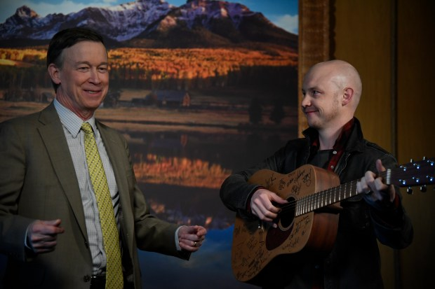 Governor Hickenlooper and Isaac Slade have