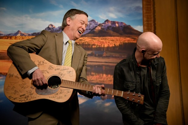 DENVER, CO - MARCH 6: Isaac Slade and Governor Hickenlooper l=share a laugh after their PSA shoot. An exclusive on a new Colorado music foundation, an education-focused nonprofit with a powerful board of directors and the backing of Governor Hickenlooper, AEG Live Rocky Mountains and the Anschutz family, that's looking to bring more music to schools amid budget cuts for music and the arts in general. Governor Hickenlooper and Isaac Slade (The Fray) shoot a PSA to announce the foundation March 6, 2017 in Denver, Colorado at the Governors office. (Photo by John Leyba/The Denver Post)