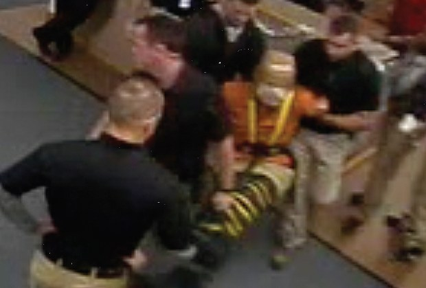 The frame from a 2016 video shows staff restraining a detainee at Colorado Division of Youth Corrections Lookout Mountain Youth Services Center.