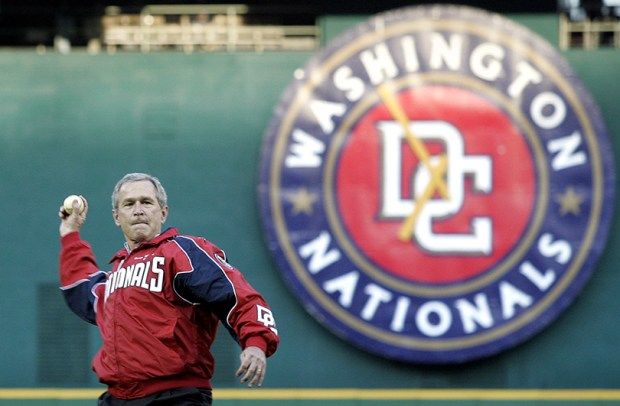 President George W. Bush throws out the first pitch of the Washington Nationals' home opener on April 14, 2005.