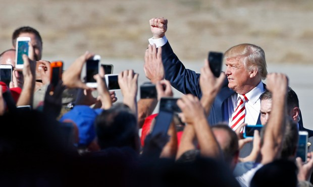 Republican presidential candidate Donald Trump greets supporters as he arrives to speak at a rally at Grand Junction Regional Airport on Oct. 18, 2016 in Grand Junction. At the rally, he pledged to bring coal jobs back to the region, but despite a bump in coal production, former mine workers have been turned away when applying for jobs.