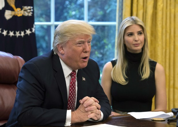 President Donald Trump is speaks next to his daughter Ivanka in the Oval Office on Monday.