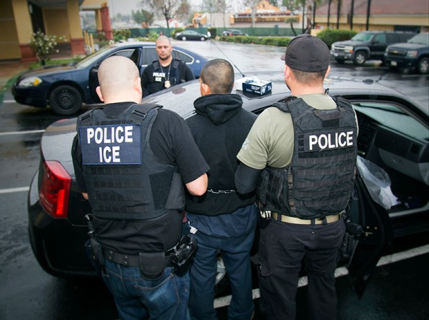 Immigration and Customs Enforcement officers arrest a suspect in Los Angeles on Feb. 7.