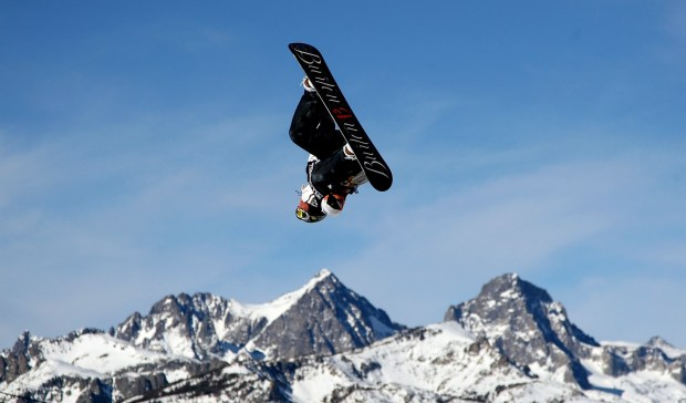 A snowboarder participates during a Jan. 7, 2010, competition at the Mammoth Mountain ski resort in California. The new Aspen Skiing Co.-KSL Capital Partners alliance is buying the Eastern Sierra's Mammoth Mountain, June Mountain, Snow Summit and Bear Mountain.