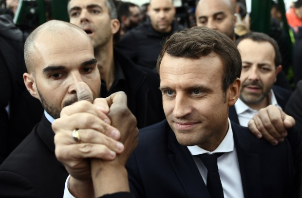 French presidential election candidate Emmanuel Macron meets youths during a campaign visit to Sarcelles, north of Paris, on Thursday.