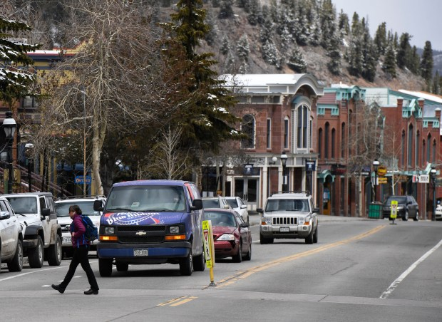 A pedestrian crosses Main St. in Breckenridge April 26, 2017.