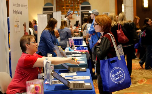 "CancerCon attendees in the exhibitor hall Friday, April 28, 2017, in Denver. 650 millennial cancer survivors, ages 15-39, arrive in Denver, Thursday, (""Stupid Cancer Day"") for their annual summit, CancerCon, produced by the nonprofit organization Stupid Cancer. (Photo by Chad Rachman for Stupid Cancer)"