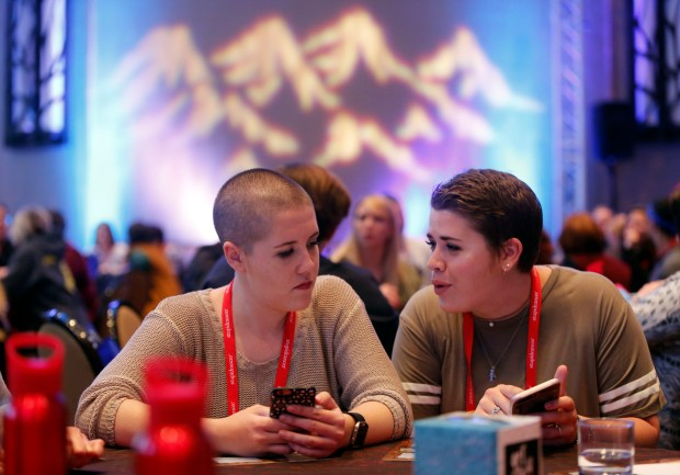 "Survivors chat before the CancerCon opening ceremony Friday, April 28, 2017, at the Sheraton Hotel in Denver. 650 millennial cancer survivors, ages 15-39, arrive in Denver, Thursday, (""Stupid Cancer Day"") for their annual summit, CancerCon, produced by the nonprofit organization Stupid Cancer. (Photo by Chad Rachman for Stupid Cancer)"