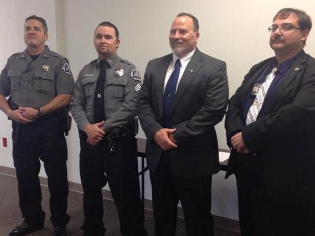Lt. Bruce Briscoe, Sgt. Adam Jackson, Sgt. Mike Jolliffe, Lt. Robert Dodd at a Fremont County Sheriff's Office promotion ceremony.