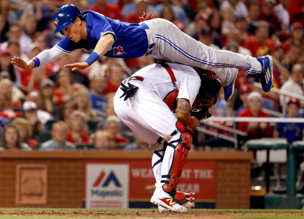Toronto Blue Jays' Chris Coghlan leaps ...