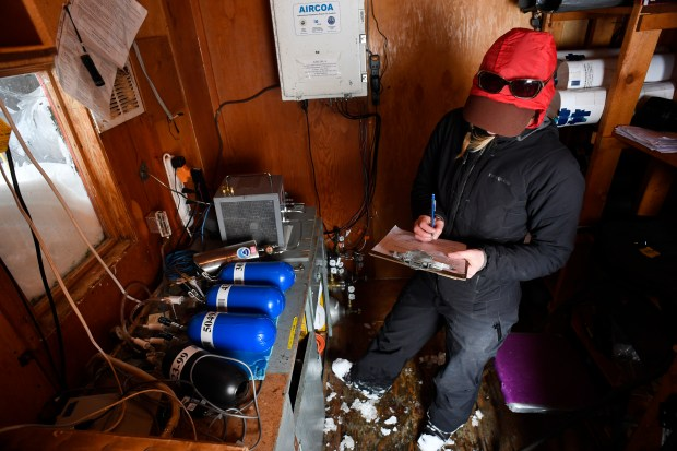 Jennifer Morse, a climate technician at ...
