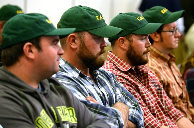 Supporters of the Farmers Alliance for Integrated Resources listen during a public hearing on the use of GMO crops in Boulder County on Feb. 29, 2016.
