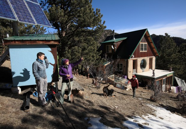 Oak Chezar (middle) is outside at her off-the-grid home with friend Kim Homer (left) and Joy Boston.