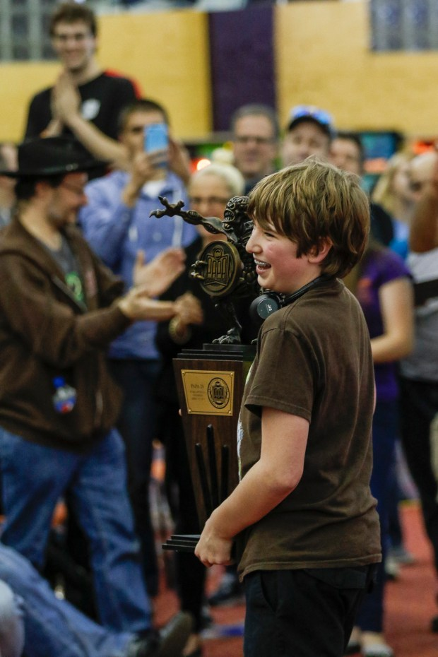 Escher Lefkoff, 13, holds the Division-A trophy at the PAPA 20 World Pinball Championships in Carnegie, Penn., on April 9.