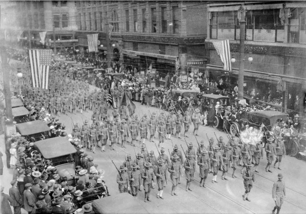 View of a parade in Denver, Colorado sometime between 1914-1918.