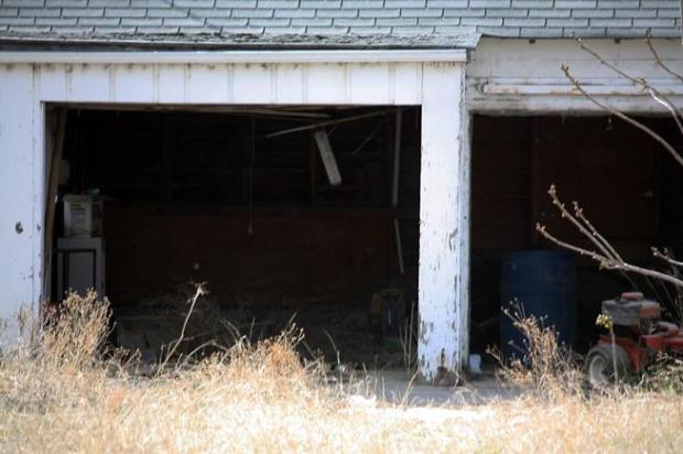 The body of Santos De Santiago Macias, 40, of Fort Morgan was found in this garage located on the outskirts of Fort Morgan at the intersection of Highway 34 and Saunders Road