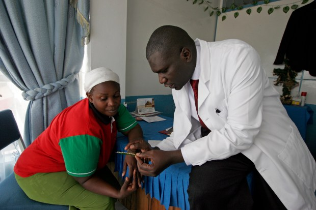 A doctor discusses family planning with a woman in Nairobi, Kenya, on Jan. 29, 2009. Days earlier, newly elected President Barack Obama had signed an executive order allowing the U.S. to fund international family-planning clinics that promote abortion or provide counseling or referrals about abortion services. Eight years later, President Donald Trump reversed the order.
