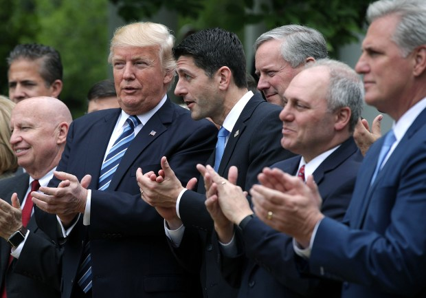 President Donald Trump, House Speaker Paul Ryan and other GOP congressional leaders celebrate passage of the American Health Care Act Thursday at the White House.