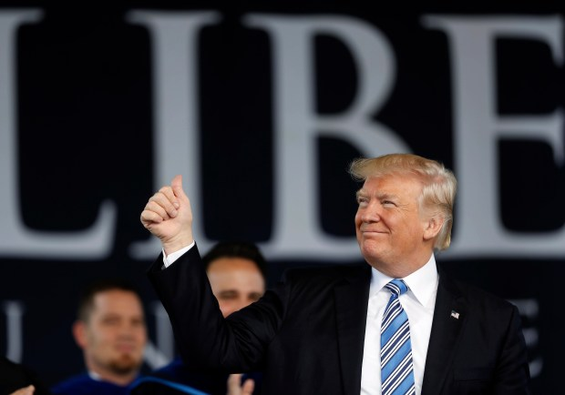 President Donald Trump acknowledges the crowd as he takes the stage to give the commencement address for the Class of 2017 at Liberty University in Lynchburg, Va., on Saturday.
