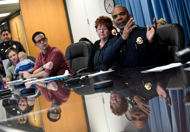 Denver Police Chief Robert White, right, speaks about the police department's policy on immigration at police headquarters on April 25.