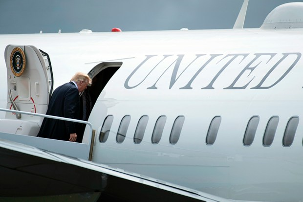 President Donald Trump boards Air Force One in Lynchburg, Va., last Saturday. This Friday, Trump will embark on a nine-day trip abroad.