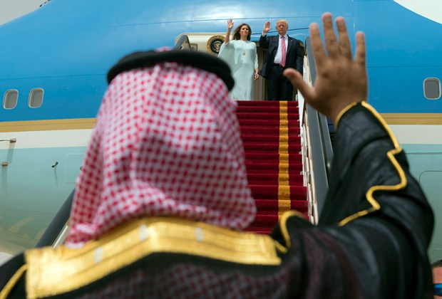 A handout picture provided by the Saudi Royal Palace shows President Donald Trump and first lady Melania Trump waving as they board Air Force One before leaving Riyadh to Israel on Monday.