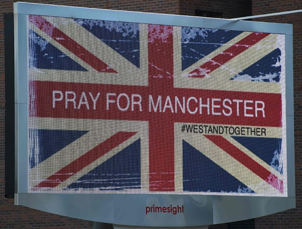 "An electronic sign displays a Union flag and the words ""Pray For Manchester"" on Tuesday in Manchester, England, a day after 22 people were killed and dozens injured after a suspected suicide bomber targeted fans leaving an Ariana Grande concert."