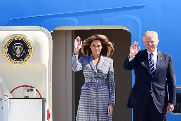 President Donald Trump and first lady Melania Trump wave as they step off Air Force One upon arrival at Melsbroek military airport in Belgium on May 24.