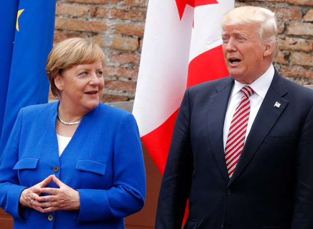 German Chancellor Angela Merkel and President Donald Trump attend the Summit of the Heads of State and of Government of the G7, at the ancient Greek Theater in Taormina, Sicily, on May 26.