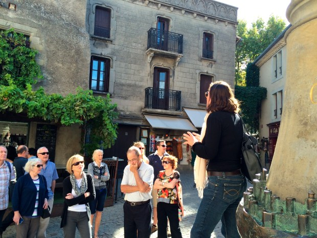 Guide Nathalie Coroner tells a tour group about Carcassonne's long and bloody history.