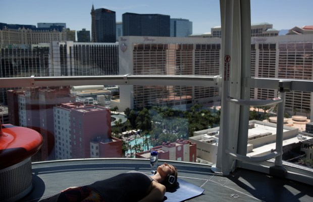 Carly Benson takes part in a yoga class at the High Roller observation wheel in Las Vegas.