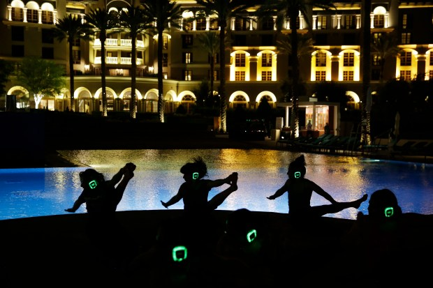 People take part in a yoga class by the pool at the Green Valley Ranch hotel and casino in Las Vegas.