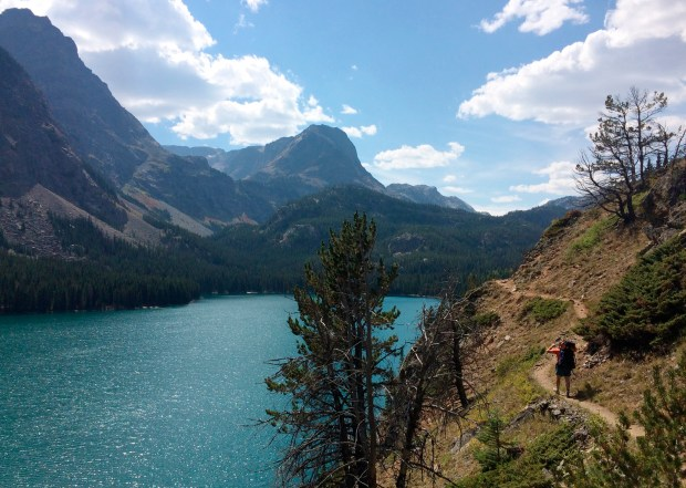 Mike Eckel hikes above a lake along the Beaten Path, a 26-mile hiking trail that crosses through Montana's Absaroka-Beartooth Wilderness.
