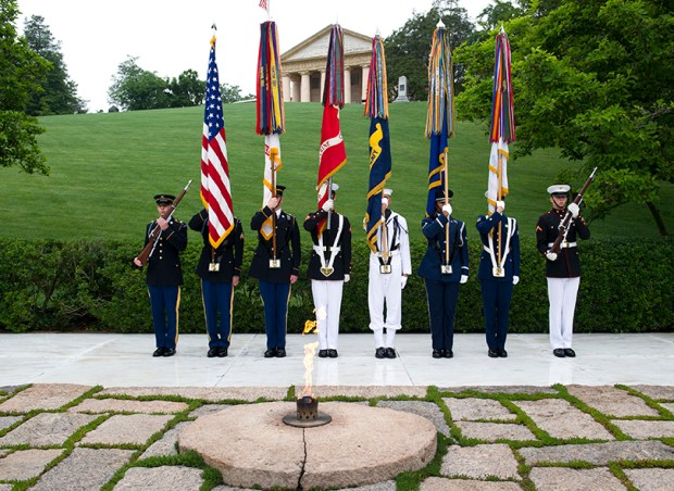 The Army Old Guard color guard stands watch during a wreath-laying ceremony, at the grave of former President John F. Kennedy, to mark the 100th anniversary of his birth, at Arlington National Cemetery on Monday.