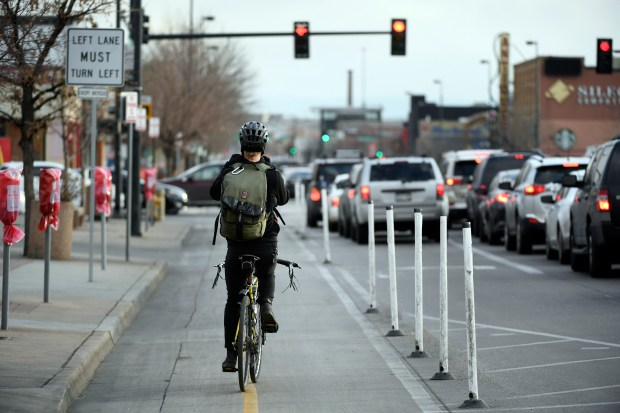 A cyclist rides in the bike lane on South Broadway in Denver on Jan. 26.
