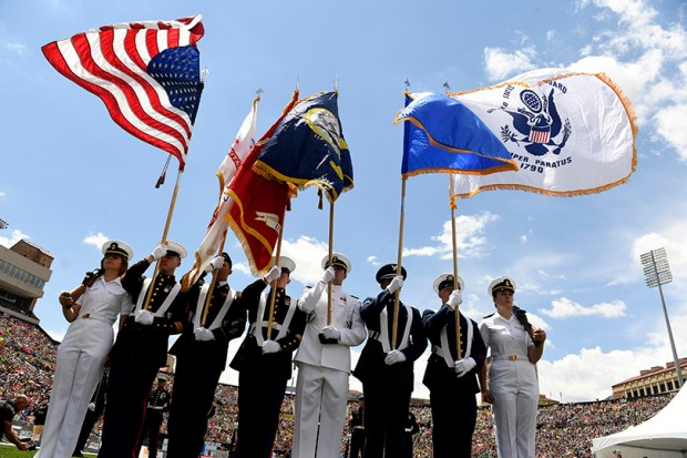 Members of the honor guard present the nation's colors during a Memorial Day tribute at Folsom Field after the running of the Bolder Boulder road race on Monday.