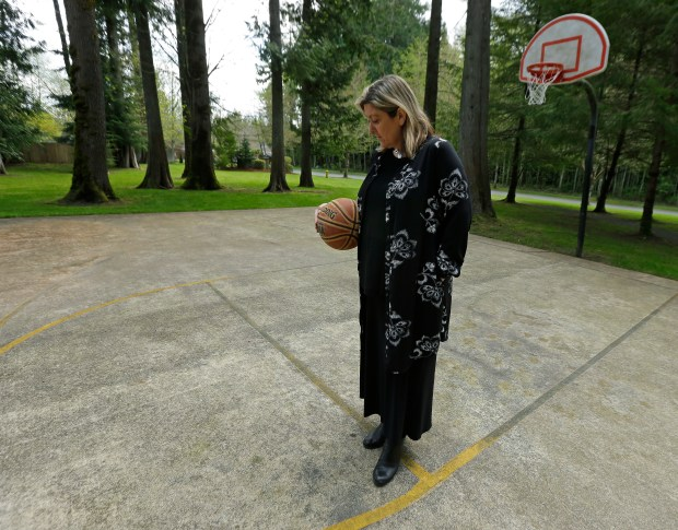 Amanda Jackson holds a basketball that ...