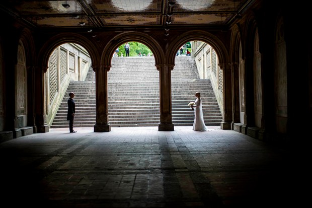A bride and groom pose for their wedding pictures at the Bethesda Terrace in New York's Central Park on Tuesday. More and more Americans are marrying people of different races and ethnicities, reaching at least 1 in 6 newlyweds in 2015, the highest proportion in American history, a new study shows.