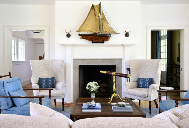 In the living room, nautical antiques and decorative touches point to the family's sailing roots. The sailboar model over the mantel dates to the late 1800s. The room is shown May 10, 2017, in Harwood, Maryland.
